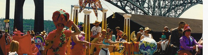 """Solstice Parade 1992 Aurora Bridge"" by Joe Mabel - Photo by Joe Mabel. Licensed under CC BY-SA 3.0 via Commons - https://commons.wikimedia.org/wiki/File:Solstice_Parade_1992_Aurora_Bridge.jpg#/media/File:Solstice_Parade_1992_Aurora_Bridge.jpg"