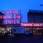 """PikePlaceMarket"" by Alex Reynolds - http://www.flickr.com/photos/alexreynolds/1976148764/sizes/o/in/set-72157603097354410/. Licensed under CC BY-SA 3.0 via Wikipedia - https://en.wikipedia.org/wiki/File:PikePlaceMarket.jpg#/media/File:PikePlaceMarket.jpg"
