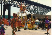 """""""Solstice Parade 1992 Aurora Bridge"""" by Joe Mabel - Photo by Joe Mabel. Licensed under CC BY-SA 3.0 via Commons - https://commons.wikimedia.org/wiki/File:Solstice_Parade_1992_Aurora_Bridge.jpg#/media/File:Solstice_Parade_1992_Aurora_Bridge.jpg"""
